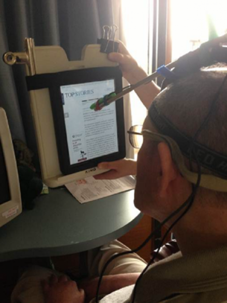 Participant (P1) accessing his iPad device using makeshift head pointer